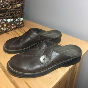 Clark's slip on brown clog with button accent